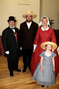 From left: Jim Fouts, Bob Bushnell, Lynn Sawyer, and Mackenzie Smith bring St. Albans back in time, to the 1860s, with Civil War-era clothing as presented Wednesday night at the St Albans Historical Museum's Bliss Auditorium, itself standing during the St. Albans Raid.
