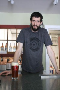 14th Star Brewery brewmaster Dan Sartwell show off his new creation The Raider.