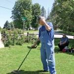 Bill Donlon of Enosburgh uses a metal detector to search a Sheldon site for historic artifacts.